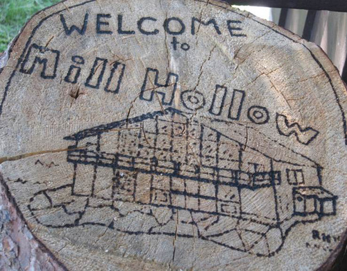 | Courtesy Mill Hollow Outdoor Education Center The Mill Hollow Outdoor Education Center welcome sign was made by a staff member using a magnifying glass and sunlight over the course of a couple of weeks. The center is owned and operated by Granite School District in the Uinta Mountains at an elevation of 8,900 feet. Educational programs during the day are designed to actively involve students in outdoor learning activities, wildlife observation and nature trail hikes. Qualified teachers provide students with unique learning opportunities in various subjects including plants, animals, geology, ecology, astronomy, and the environment. This would have been the center's 50th summer of serving school kids, but a lack of funding may end the popular learning opportunity.