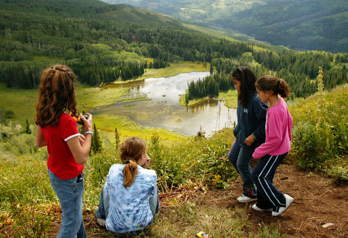 Tribune file photo  James E. Moss Elm. 5th graders look down and take pictures at Heart Lake during a hike at Mill Hollow in this 2005 file photo.