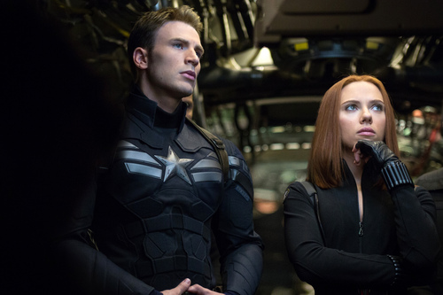 "This image released by Marvel shows Chris Evans, left, and Scarlett Johansson in a scene from ""Captain America: The Winter Soldier."" (AP Photo/Marvel-Disney)"
