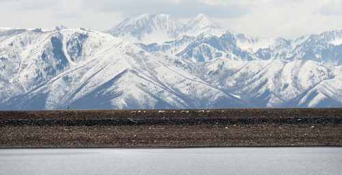 Steve Griffin  |  The Salt Lake Tribune  Low water levels at Jordenelle Reservoir exposes more of the dam near Heber, Utah Friday, April 4, 2014. The Natural Resources Conservation Service issued its Utah Water supply Outlook report, showing that the water situation is better in northern Utah than southern Utah.