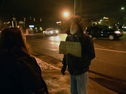 "Al Hartmann  |  The Salt Lake Tribune	 Lilian Browne, case manager with Volunteers of America, interviews  ""Steven"" a homeless man, Wednesday Jan. 30, 2014, at 5:30 a.m. in downtown Salt Lake City. He panhandles for change on the sidewalk outside the McDonalds drive through at 500 South. Each year, Volunteers of America, in conjunction with other agencies, takes a head count of homeless people living on the streets of Salt Lake City."