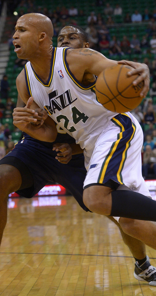 Leah Hogsten  |  The Salt Lake Tribune Utah Jazz forward Richard Jefferson (24) is fouled by New Orleans Pelicans forward Darius Miller (2) during the first half of their game Friday, April 4, 2014 at Energy Solutions Arena.