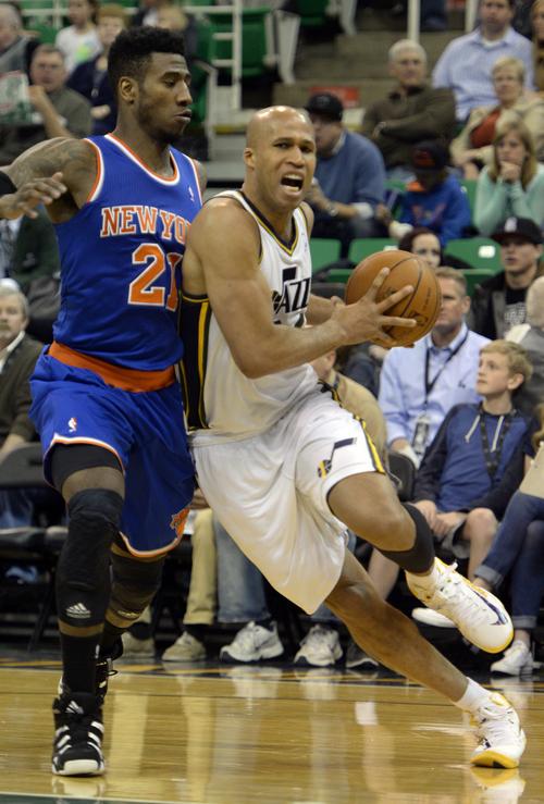 Rick Egan  |  The Salt Lake Tribune  Utah Jazz forward Richard Jefferson (24) takes the ball past New York Knicks guard Iman Shumpert (21), in NBA action, Utah Jazz vs. the New York Knicks, at EnergySolutions arena, Monday, March 31, 2014