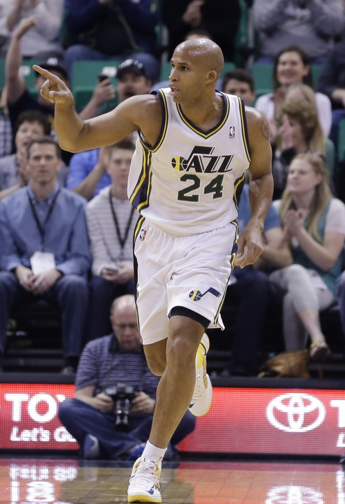 Utah Jazz's Richard Jefferson (24) points upcourt after scoring against the Orlando Magic in the first quarter during an NBA basketball game on Saturday, March 22, 2014, in Salt Lake City. (AP Photo/Rick Bowmer)