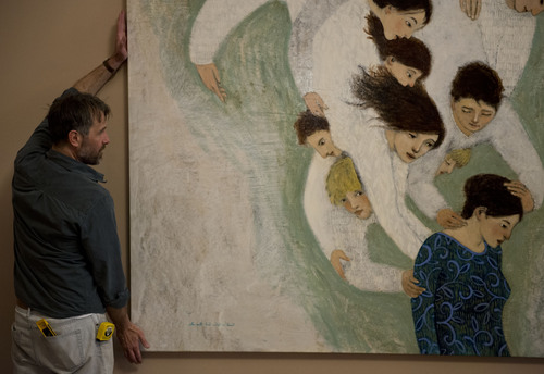 Lennie Mahler  |  The Salt Lake Tribune Artist Brian Kershisnik straightens a painting on the first floor of the LDS Conference Center on Thursday, April 3, 2014.