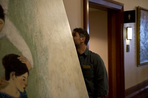 Lennie Mahler  |  The Salt Lake Tribune Artist Brian Kershisnik hangs one of his paintings up on the first floor of the LDS Conference Center on Thursday, April 3, 2014.