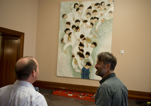 Lennie Mahler  |  The Salt Lake Tribune Artist Brian Kershisnik and Cris Baird observe the painting hung on the first floor of the LDS Conference Center on Thursday, April 3, 2014.