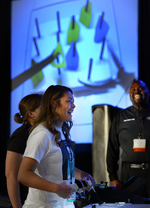 "Scott Sommerdorf   |  The Salt Lake Tribune Keli Lynn Kennerley competes in the ""peg pass"" challenge during the interactive experience competition to find the participant best at a range of video games that tested dexterity. SAGES, the Society of American Gastrointestinal and Endoscopic Surgeons, is sponsoring a mini medical school boot camp for Utah high school students as part of its conference in Salt Lake City on Saturday."