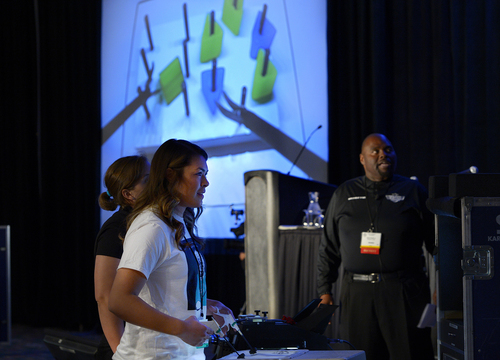 "Scott Sommerdorf   |  The Salt Lake Tribune Keli Lynn Kennerley competes in the ""peg pass"" challenge during the interactive experience competition to find the participant best at a range of video games that tested dexterity. SAGES, the Society of American Gastrointestinal and Endoscopic Surgeons, is sponsoring a mini medical school boot camp for Utah high school students as part of its conference in SLC, Saturday, April 5, 2014."