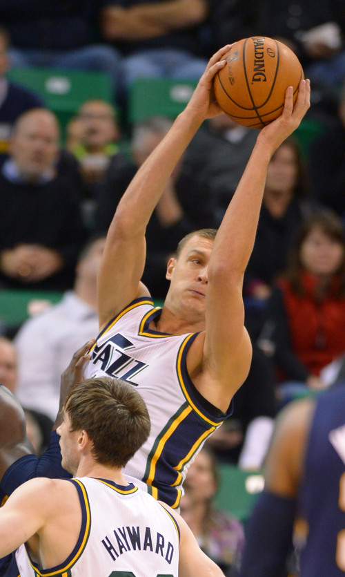 Steve Griffin  |  The Salt Lake Tribune   Utah Jazz center Andris Biedrins (11) hauls down a rebound during second half action in the Utah Jazz versus Indiana Pacers at EnergySolutions Arena in Salt Lake City, Utah Wednesday, December 4, 2013.