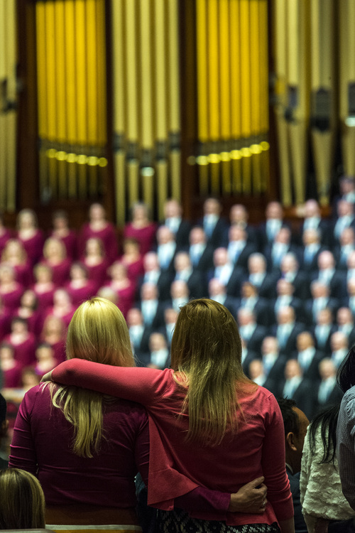 Chris Detrick  |  The Salt Lake Tribune Two women embrace as members of the Mormon Tabernacle Choir sing 'Choose the Right' 'during the morning session of the 184th Semiannual General Conference of The Church of Jesus Christ of Latter-day Saints Saturday April 5, 2014.