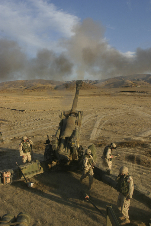 Department of Defense photo by Cpl. James L. Yarboro, U.S. Marine Corps. U.S. Army soldiers of Fox Battery, 7th Field Artillery, fire a 155mm M198 Towed Howitzer during an artillery training exercise near Khowst, Afghanistan, on Jan. 9, 2005. The Fox battery soldiers are using the training opportunity to hone their ability to provide destructive, suppressive and protective indirect and direct field artillery fires with the howitzer.