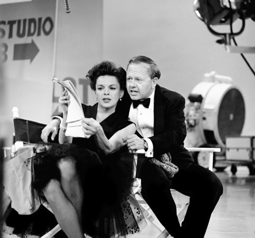FILE - In this June 26, 1963, file photo, Judy Garland and Mickey Rooney put their heads together over a television script for their first onstage reunion in 18 years, for the taping of the first of 32 variety shows which Garland will do for CBS next season. Rooney, a Hollywood legend whose career spanned more than 80 years, has died. He was 93. Los Angeles Police Commander Andrew Smith said that Rooney was with his family when he died Sunday, April 6, 2014, at his North Hollywood home. (AP Photo/File)
