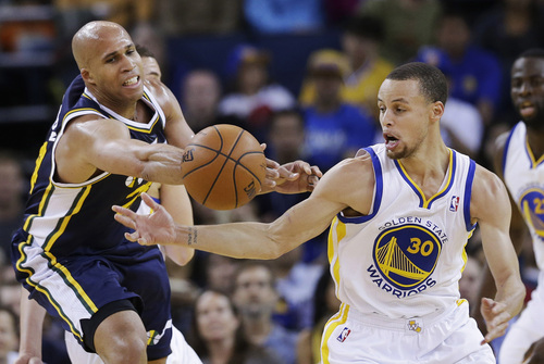 Golden State Warriors guard Stephen Curry (30) strips the ball from Utah Jazz forward Richard Jefferson, left, during the first half of an NBA basketball game Sunday, April 6, 2014, in Oakland, Calif. (AP Photo/Marcio Jose Sanchez)