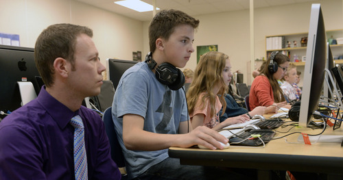 Al Hartmann  |  The Salt Lake Tribune Teacher Adam Huffaker administers state SAGE testing on Friday, April 3, to sixth grade students at Fox Hollow Elementary School in Lehi. He makes sure every student's computer is ready to go and answers technical questions if needed.  Some parents at the school in the Alpine District are having their children opt out of the computer adaptive testing.