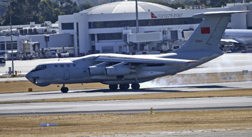 "A Chinese Ilyushin IL-76s aircraft touches down at Perth International Airport after returning from search operations for wreckage and debris of the missing Malaysia Airlines Flight MH370, in Perth, Australia, Monday, April 7, 2014. Underwater sounds detected by a ship searching the southern Indian Ocean for the missing Malaysia Airlines jet are consistent with the pings from aircraft black boxes, an Australian official said Monday, dubbing it ""a most promising lead"" in the monthlong hunt for the vanished plane. Angus Houston, the head of a joint agency coordinating the search, warned that it could take days to confirm whether the signals picked up by the Australian navy ship Ocean Shield are indeed from the black boxes that belonged to Flight 370, but called the discovery very encouraging. (AP Photo/Rob Griffith)"