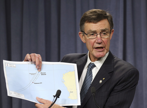 The chief coordinator of the Joint Agency Coordination Center retired Chief Air Marshall Angus Houston shows a map to the media during a press conference about the on going search operations for wreckage and debris of missing Malaysia Airlines Flight 370 in Perth,  Australia, Monday, April 7, 2014. Houston reported the towed pinger locator deployed from the Ocean Shield has detected two signals consistent with those emitted by an in flight back box recorder, in the northern part of the current search area in the southern Indian Ocean. (AP Photo/Rob Griffith)