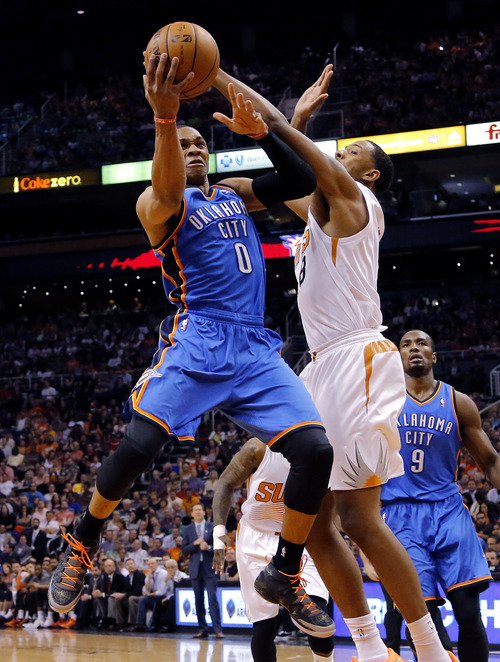 Oklahoma City Thunder guard Russell Westbrook (0) drives as Phoenix Suns forward Channing Frye (8) defends during the first half of an NBA basketball game on Sunday, April 6, 2014,in Phoenix. (AP Photo/Matt York)