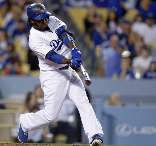 Los Angeles Dodgers' Hanley Ramirez hits a solo home run in the eighth inning, his second of the baseball game against the San Francisco Giants on Sunday, April 6, 2014, in Los Angeles. The Dodgers won 6-2. (AP Photo/Alex Gallardo)
