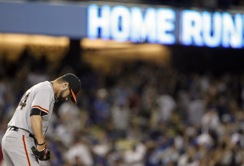 San Francisco Giants relief pitcher David Huff looks down after giving up a solo home run to Los Angeles Dodgers' Hanley Ramirez in the eighth inning of a baseball game Sunday, April 6, 2014, in Los Angeles. The Dodgers won 6-2. (AP Photo/Alex Gallardo)