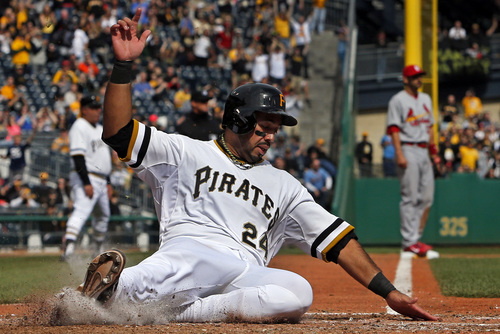 Pittsburgh Pirates' Pedro Alvarez (24) scores on a double by Pirates' Tony Sanchez off St. Louis Cardinals starting pitcher Adam Wainwright during the seventh inning of a baseball game in Pittsburgh, Sunday, April 6, 2014. The Pirates won 2-1. (AP Photo/Gene J. Puskar)