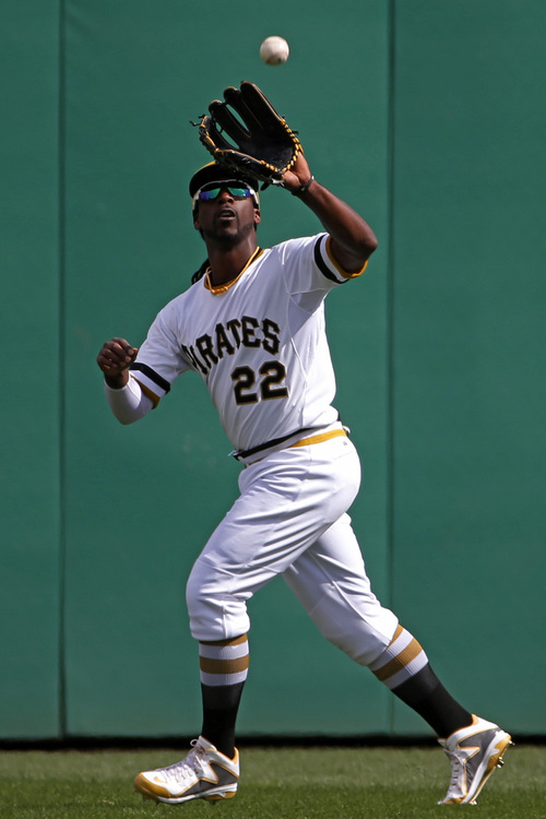 Pittsburgh Pirates' Andrew McCutchen runs down a fly ball hit by St. Louis Cardinals' Matt Carpenter to end the top of the eighth inning during a baseball game in Pittsburgh, Sunday, April 6, 2014. The Pirates won 2-1. (AP Photo/Gene J. Puskar)