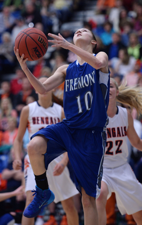 Steve Griffin  |  The Salt Lake Tribune   Fremont's Shelbee Molen shoots under the basket during 5A semifinal basketball game against Brighton at SLCC Bruin Arena/Lifetime Activities Center in Taylorsville, Utah Friday, February 28, 2014.