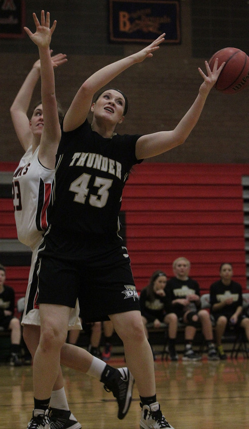 Leah Hogsten  |  The Salt Lake Tribune Desert Hills' Haley Bodnar can't make the rebound.  Desert Hills girls' basketball team defeated Alta High School 68-52 at Alta, Friday, December 20, 2013.