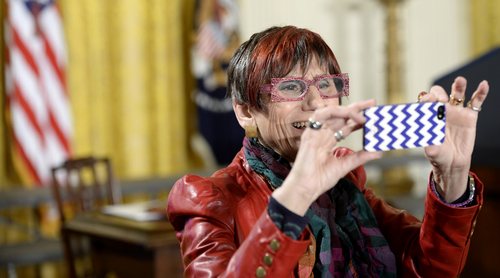 Rep. Rosa DeLauro, D-Conn. takes a photo in the East Room of the White House in Washington, Tuesday, April 8, 2014, before an event marking Equal Pay Day. President Barack Obama announced new executive actions to strengthen enforcement of equal pay laws for women. The president and his Democratic allies in Congress are making a concerted election-year push to draw attention to women's wages. (AP Photo/Susan Walsh)