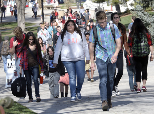 "Al Hartmann  |  The Salt Lake Tribune University of Utah students head to class on April 8.  The student government on Tuesday, April 22, 2014, voted to urge universityadministrators to change lyrics for the school's fight song, ""Utah Man."" Some lyrics of ""Utah Man"" can be considered sexist and racist."