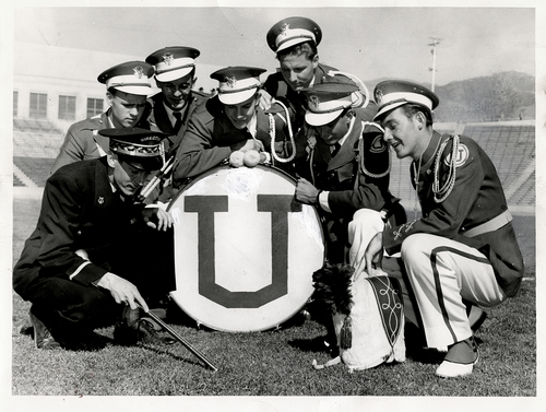 """Tribune file photo  The original caption on this 1948 photo says: """"Just before the big game bandsmen gather with Director Ronald D. Gregory for skull practice. Left to right are Gerald Epperson, Bill Rokes, Kenn Millard and Lee Wright, all of Salt Lake, with Drum major Bill Rhead."""""""