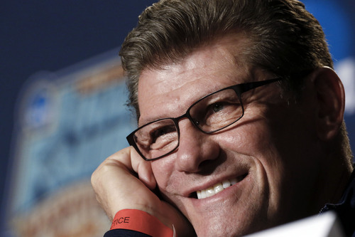 Connecticut head coach Geno Auriemma listens to a question during a news conference at the NCAA women's Final Four college basketball tournament Monday, April 7, 2014, in Nashville, Tenn. Connecticut is scheduled to face Notre Dame in the championship game Tuesday. (AP Photo/John Bazemore)