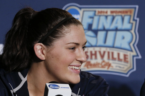 Connecticut center Stefanie Dolson answers questions during a news conference at the NCAA women's Final Four college basketball tournament Monday, April 7, 2014, in Nashville, Tenn. Connecticut is scheduled to face Notre Dame in the championship game Tuesday. (AP Photo/John Bazemore)