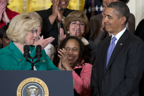 Women's rights activist Lilly Ledbetter, left, acknowledges President Barack Obama as she speaks in the East Room of the White House in Washington, Tuesday, April 8, 2014, during an event marking Equal Pay Day. The president also announce new executive actions to strengthen enforcement of equal pay laws for women. The president and his Democratic allies in Congress are making a concerted election-year push to draw attention to women's wages, linking Obama executive actions with pending Senate legislation aimed at closing a compensation gender gap that favors men. (AP Photo/Carolyn Kaster)