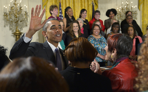 President Barack Obama greets Rep. Rosa DeLauro, D-Conn., front right, and others in the crowd after speaking in the East Room of the White House in Washington, Tuesday, April 8, 2014, during an event marking Equal Pay Day. Obama announced new executive actions to strengthen enforcement of equal pay laws for women. The president and his Democratic allies in Congress are making a concerted election-year push to draw attention to women's wages. (AP Photo/Susan Walsh)