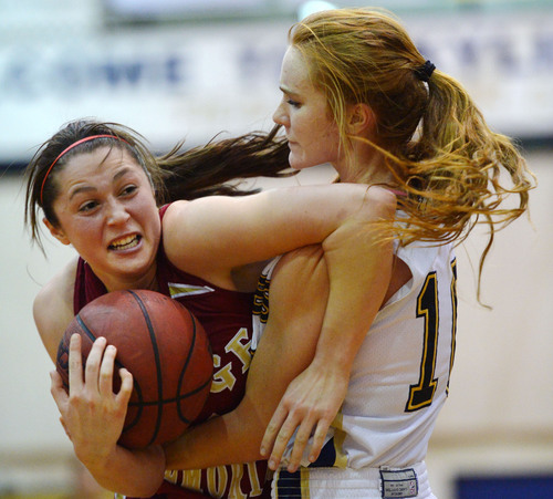 Steve Griffin  |  The Salt Lake Tribune   Judge's Kailie Quinn, left, can't get away from the grip of  Skyline's Mia Mortensen during game at Skyline High School in Salt Lake City, Utah Wednesday, December 18, 2013.