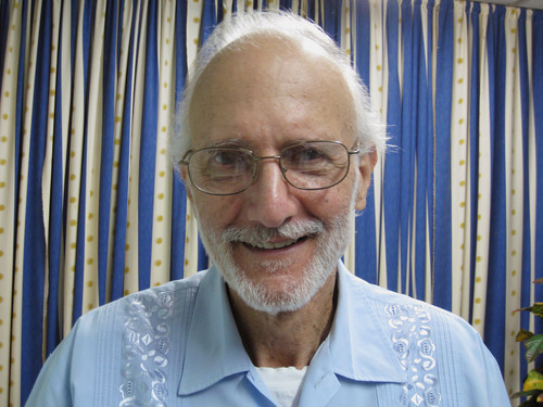 FILE - In this Nov. 27, 2012 file photo provided by U.S. lawyer James L. Berenthal, jailed American Alan Gross poses for a photo during a visit by Rabbi Elie Abadie and Berenthal at Finlay military hospital in Havana, Cuba. Gross, a U.S. government subcontractor imprisoned in Cuba, released a statement through his lawyer Tuesday, April 8, 2014, saying he began fasting to protest his treatment by the governments of Cuba and the United States. (AP Photo/James L. Berenthal, File)