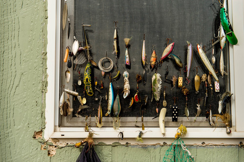 Trent Nelson  |  The Salt Lake Tribune Fishing lures hanging from a window screen along Guides' Row in Dutch John, Friday, March 21, 2014.