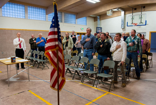 Trent Nelson  |  The Salt Lake Tribune Citizens recite the pledge of allegiance at a Republican party caucus meeting at the Flaming Gorge School in Dutch John, Thursday, March 20, 2014.