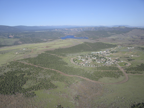 Brett Prettyman |  Tribune file photo The community of Dutch John in northeastern Utah is considering incorporation after decades of being a federal town created to build and support Flaming Gorge Reservoir. This aerial picture was taken in 2010. The water in the background is Flaming Gorge Reservoir.