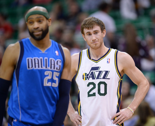 Steve Griffin  |  The Salt Lake Tribune   Utah Jazz guard Gordon Hayward (20), right, shrugs as Dallas Mavericks guard Vince Carter (25) smiles as the last seconds tic off the clock as the Jazz loose game against the Mavericks NBA at EnergySolutions Arena in Salt Lake City, Utah Tuesday, April 8, 2014.