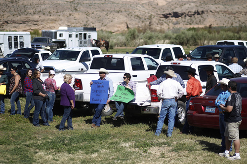John Locher  |  The Associated Press Supporters prepare to rally for Cliven Bundy last week at the Bundy ranch near Bunkerville Nev.