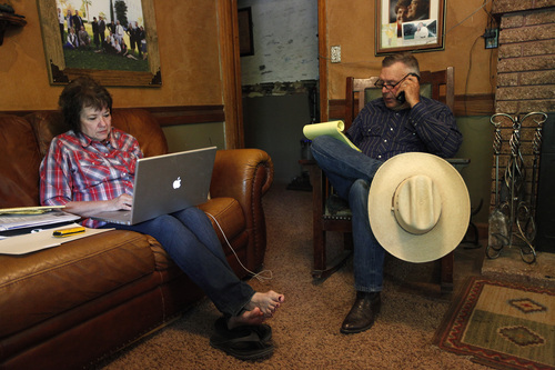 "Cliven Bundy, right, and his wife Carol Bundy make calls and look online at their ranch near Bunkerville Nev. Saturday, April 5, 2014. The Bureau of Land Management has begun to round up what they call ""trespass cattle"" that rancher Cliven Bundy has been grazing in the Gold Butte area 80 miles northeast of Las Vegas.  (AP Photo/Las Vegas Review-Journal, John Locher)"