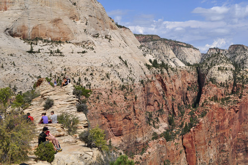Erin Alberty  |  The Salt Lake Tribune Hikers relax on Angels Landing.