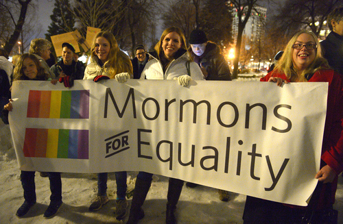 Rick Egan  |  Tribune file photo   L-R Alish Megan and Julie Ogden, Sunnyvale California, and Mikaela Dufur, Orem, hold a sign at the ìCelebrate Marriage Equality Rallyî at Washington Square,Monday, December 23, 2013.