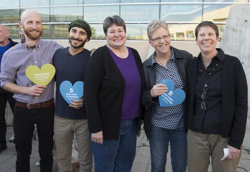 "Rick Egan  |  The Salt Lake Tribune  Plantiffs, Derek Kitchen, Moudi Sbeity, Kate Call, Laurie Wood, and Kody Partridge, at the Utah Unites for Marriage ""send-off"" event Monday night at Library Square, Monday, April 7, 2014"