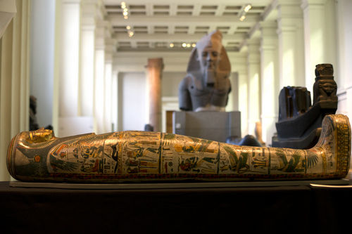 The Mummy of Tamut, a temple singer around 900 BC, is shown during a press conference at the British Museum in London, Wednesday April 9, 2014. Scientists at the British Museum have used CT scans and volume graphics software to go beneath the bandages, revealing the skin, bones, internal organs, and in one case a brain-scooping rod left inside a skull by embalmers. The results are going on display in an exhibition which sets eight of the museum's mummies alongside detailed 3-D images of their insides. (AP Photo/Alastair Grant)