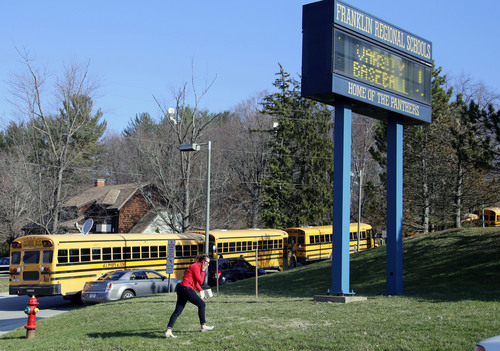 A woman walks onto the campus of the Franklin Regional School District where several people were stabbed at Franklin Regional High School on Wednesday, April 9, 2014, in Murrysville, Pa., near Pittsburgh. The suspect, a male student, was taken into custody and being questioned. (AP Photo/Gene Puskar)