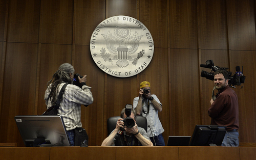 Scott Sommerdorf   |  The Salt Lake Tribune Photographers capture views from the judge's seat inside one of the courtrooms during a media tour of the new Salt Lake City federal courthouse, Wednesday, April 9, 2014.