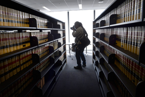 Scott Sommerdorf      The Salt Lake Tribune A photographer makes a photo inside the law library during a media tour of the new Salt Lake City federal courthouse, Wednesday, April 9, 2014.